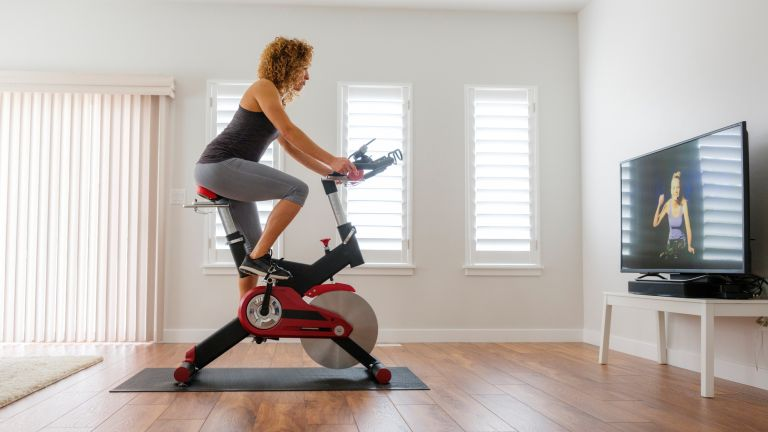 Woman using the best exercise bike