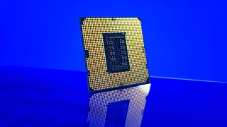 Bottom of an Intel Core i5 11400F processor on a blue background