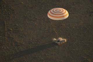 The Soyuz TMA-20M space capsule is seen landing with NASA astronaut Jeff Williams and Russian cosmonauts Oleg Skripochka and Alexey Ovchinin on the steppe of Kazakhstan, Sept. 6, 2016.