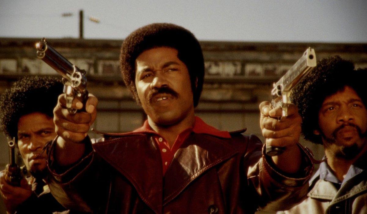 Black Dynamite aims twin pistols