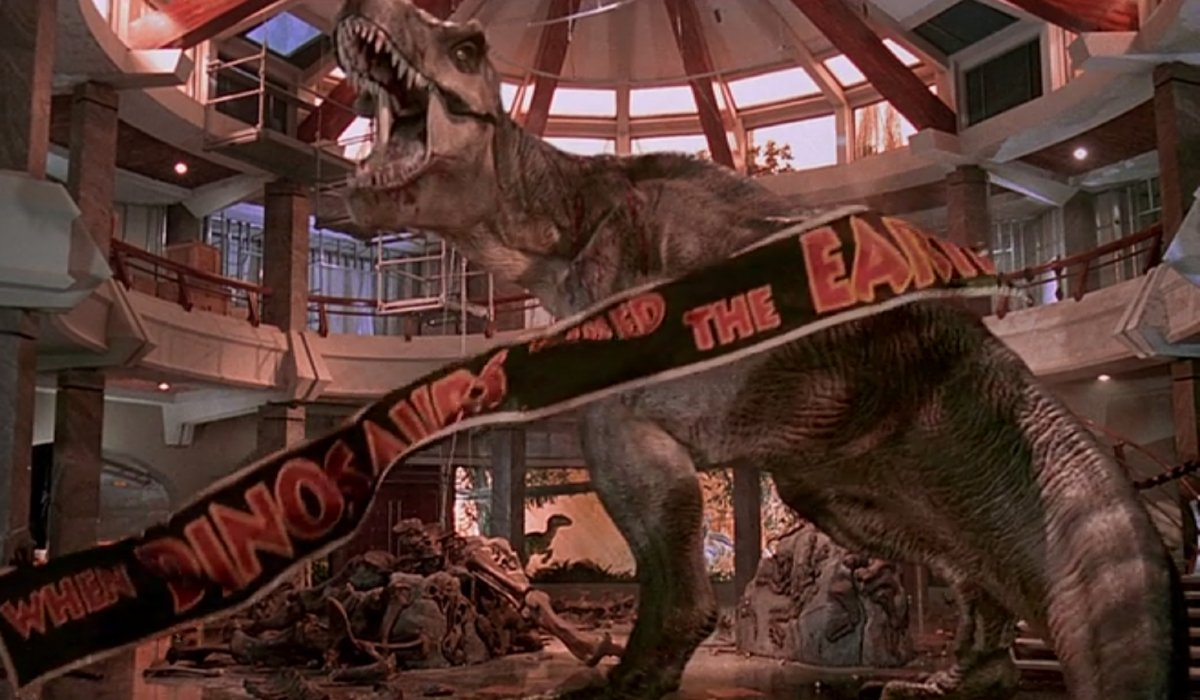 Jurassic Park Roberta the T-Rex roars in front of a falling banner