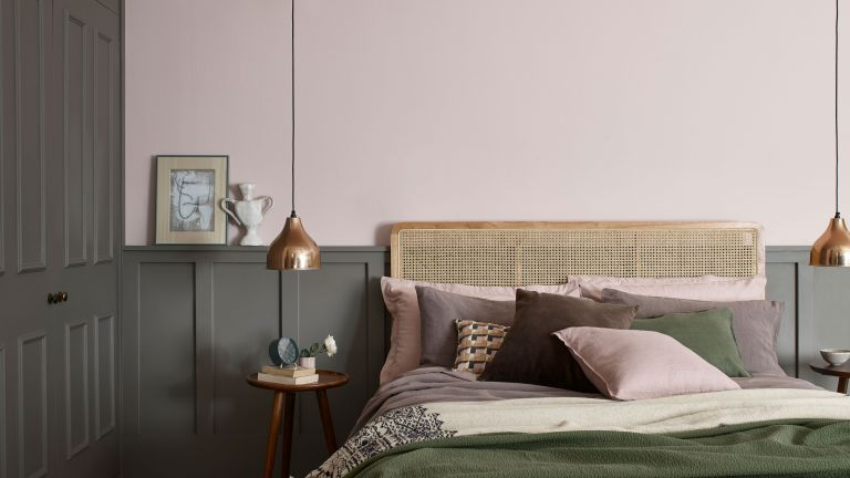 pastel pink wall in bedroom with muddy tones on cupboards