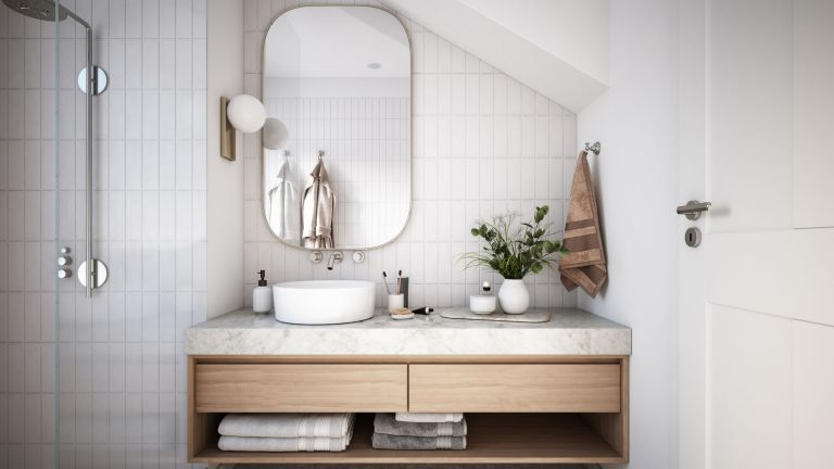 a white minimalistic bathroom with sink and shower