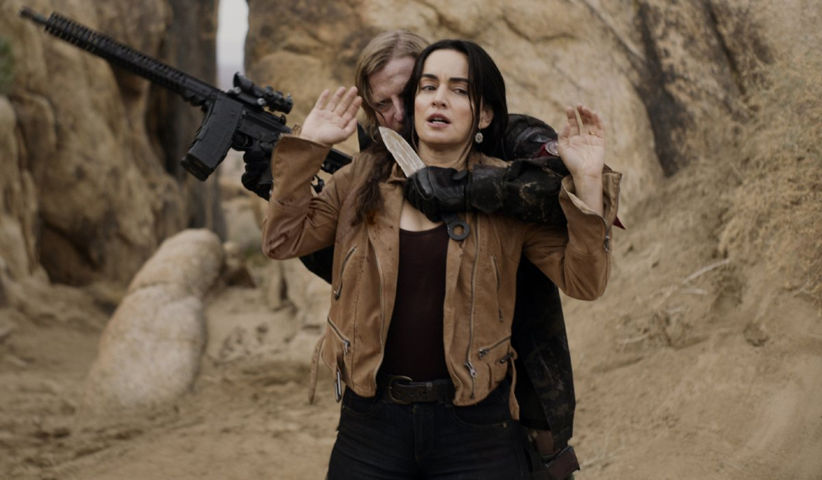Ana de la Reguera held at knifepoint in The Forever Purge.