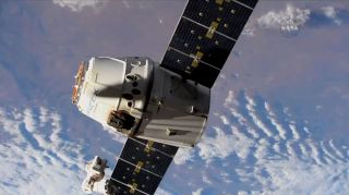 A reused Dragon cargo spacecraft was release from the International Space Station today (July 3) for a return trip to Earth.