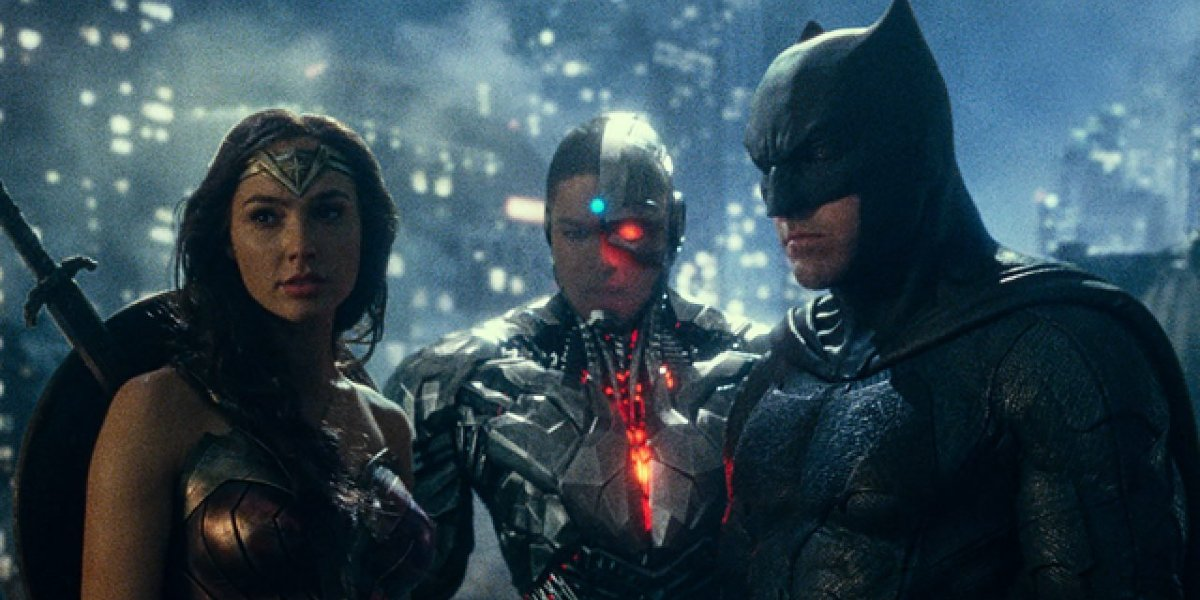 Justice League Wonder Woman, Cyborg, and Batman standing together on a rooftop
