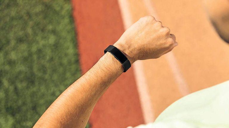 Runner wearing Fitbit Inspire HR tracker