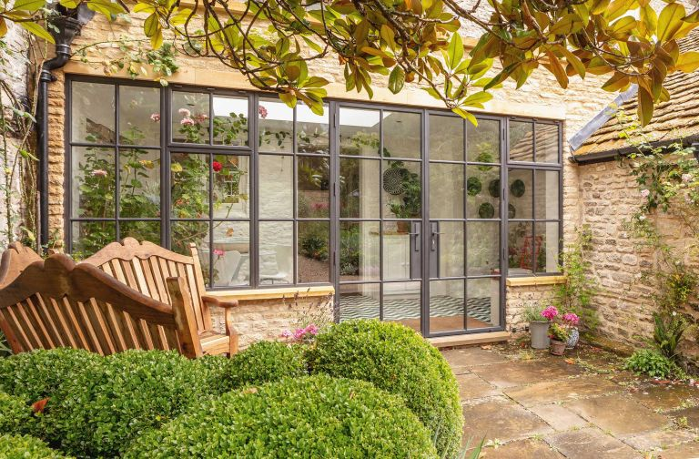 patio doors in a cotswold stone conservatory