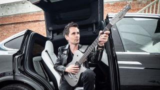 Matt Bellamy poses with a Manson META Series electric guitar
