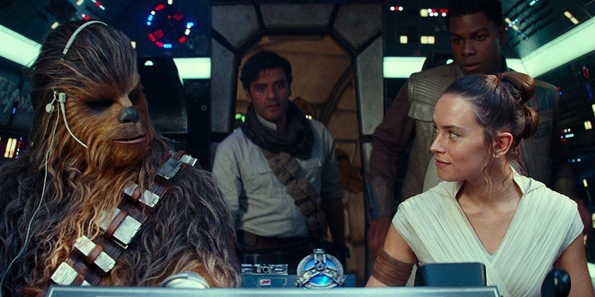 Chewbacca, Poe, Finn and Rey in the Millennium Falcon