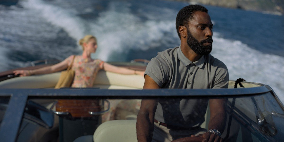 John David Washington and Elizabeth Debicki as Tenet (2020)