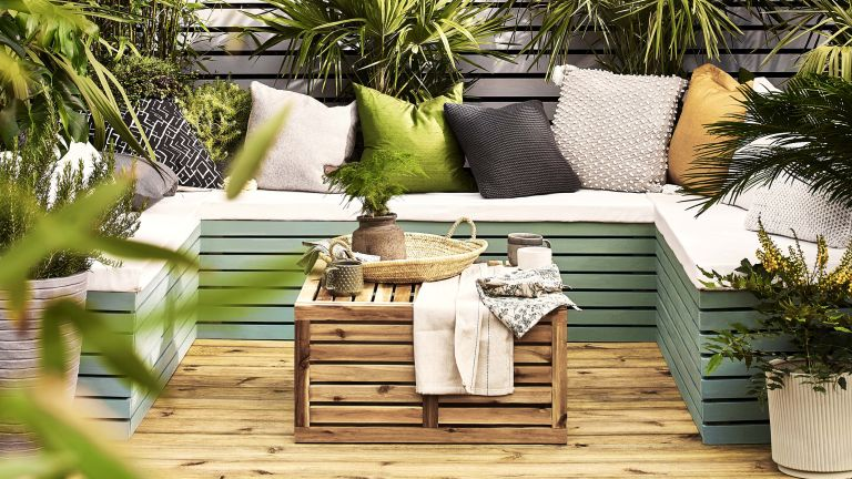 small garden ideas with decking and built in bench seating