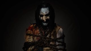 Mortiis wrapped up in chains
