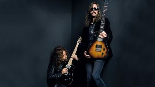 Opeth's Fredrik Åkesson [left] and Mikael Åkerfeldt with their PRS axes