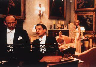 Jeremy Northam plays piano while Bob Balaban and Kristin Scott Thomas listen