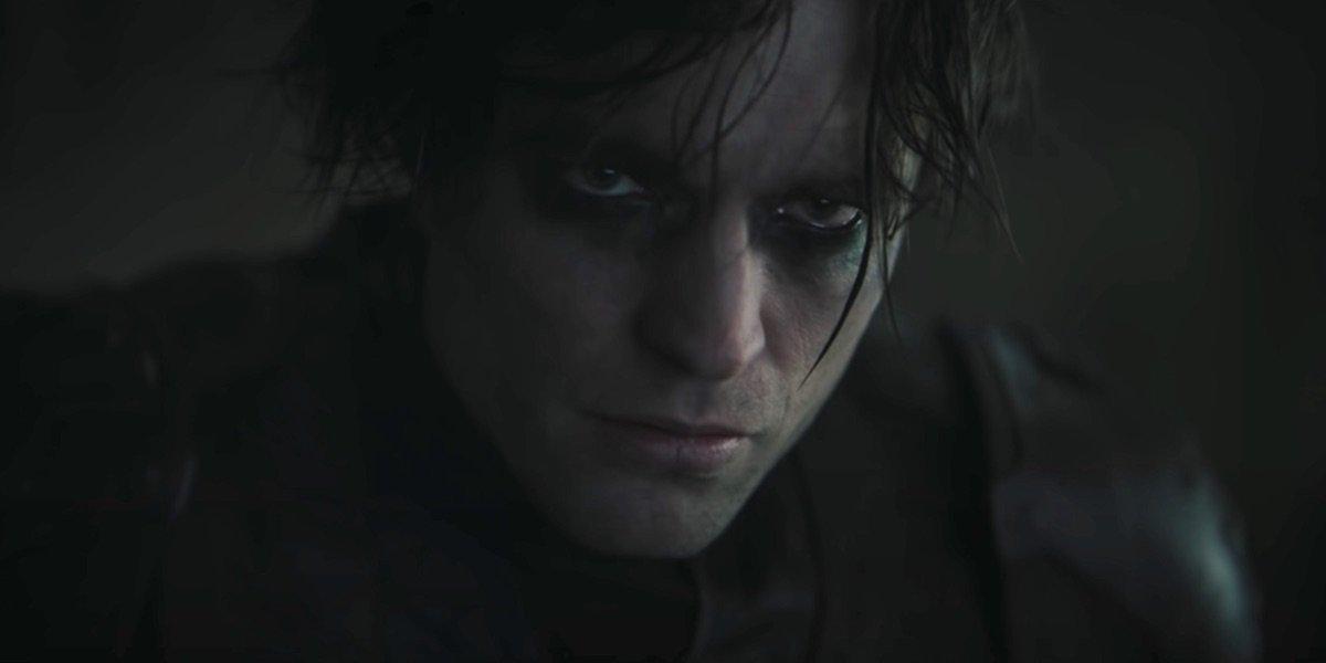 Unmasked Robert Pattinson looking moody in The Batman
