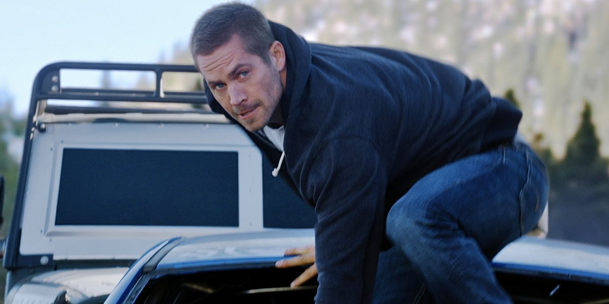Furious 7 Paul Walker stands on top of a moving car