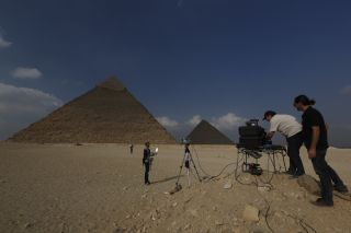 In a new scanning project, scientists hope to answer questions about the pyramids, including the Great Pyramid of Khufu (seen at right) and the Pyramid of Khafre (seen at left).