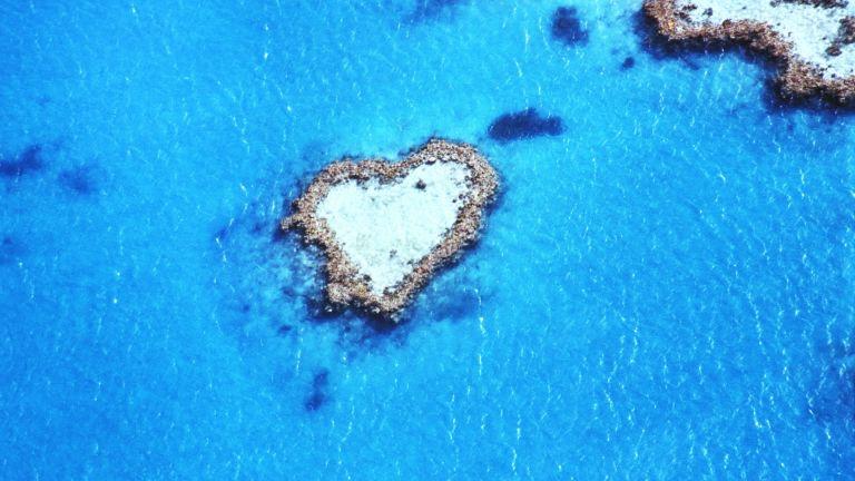 heart shaped island in blue ocean