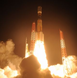 A Japanese H-IIB rocket launches the HTV-5 cargo ship toward the International Space Station on Aug. 19, 2015. Among the 4.5 tons cargo riding on HTV-5 were several samples of liquor for the Suntory Global Innovation Center to test how booze mellows in sp