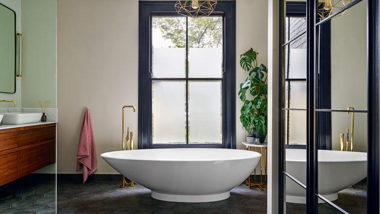 Modern bathroom with freestanding bath and large window