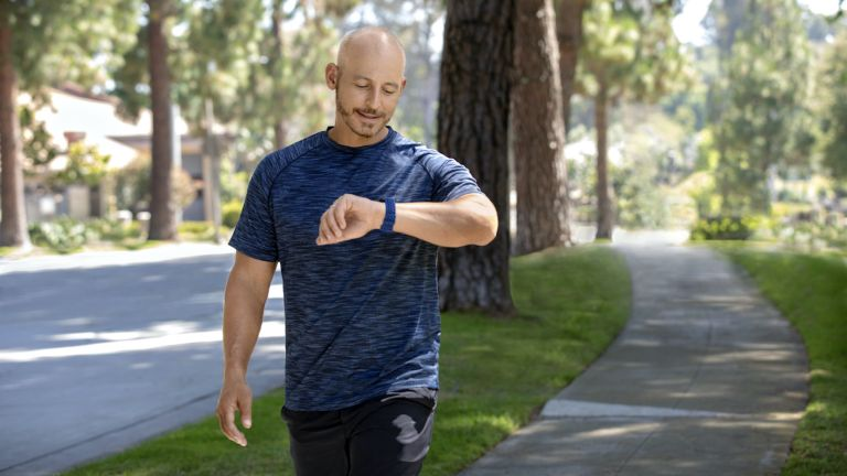 best Fitbit: man checking his Fitbit