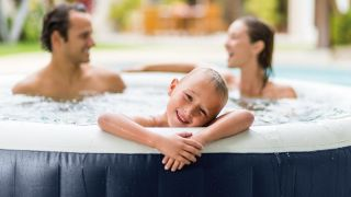 Best inflatable hot tubs 2021: image shows family in a hot tub