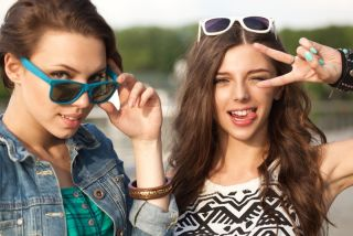 two teenage girls having fun outside
