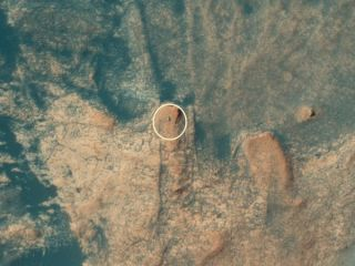 The HiRISE camera aboard NASA's Mars Reconnaissance Orbiter captured this photo of the Curiosity rover on April 18, 2021.