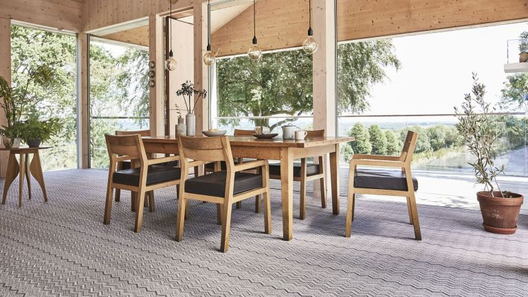 dining room with large open windows, dining furniture and patterned carpet by carpetright