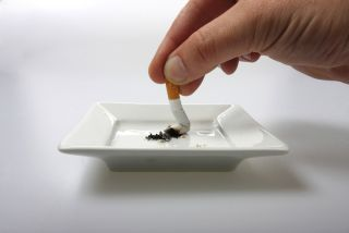 A cigarette is being ground out