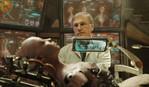 Alita: Battle Angel Christoph Waltz looks over the recovered Alita on the operating table