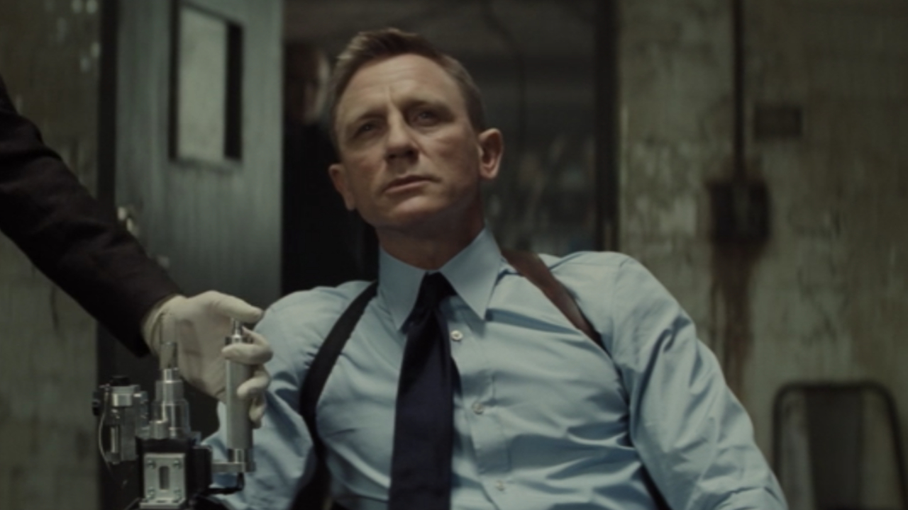 Daniel Craig gets injected with smart blood while sitting in Spectre.