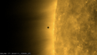 Mercury begins its transit of the sun on Nov. 11, 2019. This image was captured by NASA's Solar Dynamics Observatory as Mercury was approaching the limb of the sun to begin the transit.