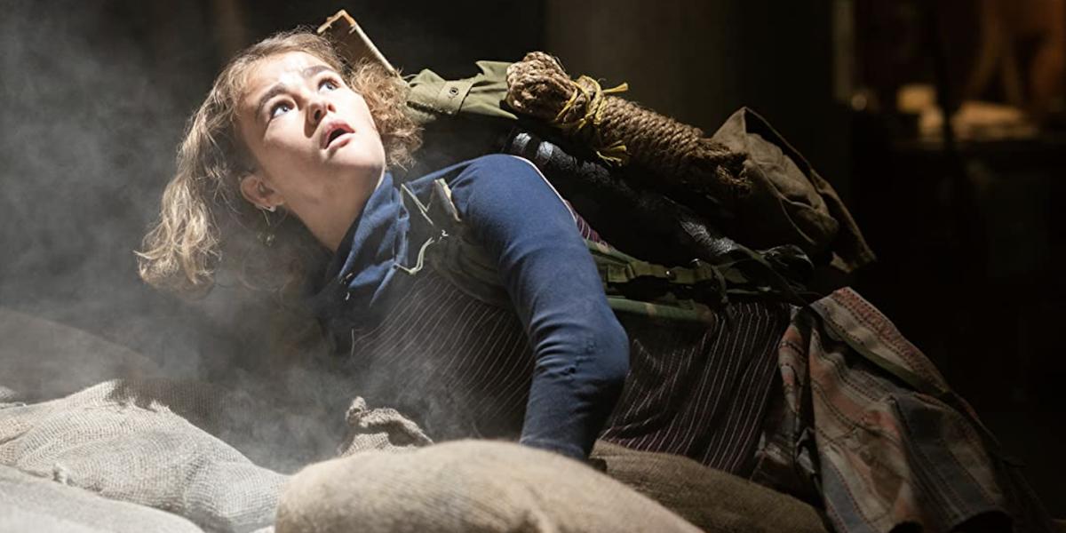 Millicent Simmonds looking up in shock as Regan in A Quiet Place: Part II