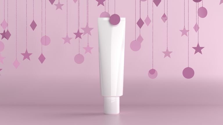 cosmetic haircare tube on urple background with confetti