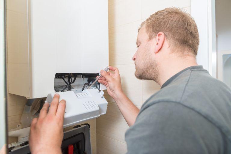 man fixing a boiler