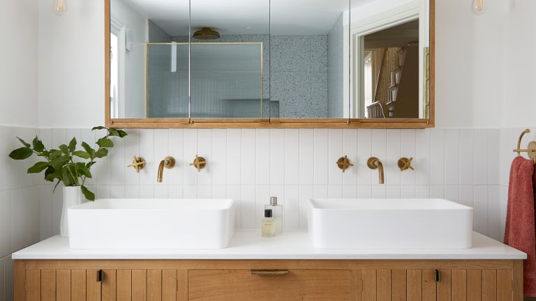 Modern bathroom with double sink and large mirror
