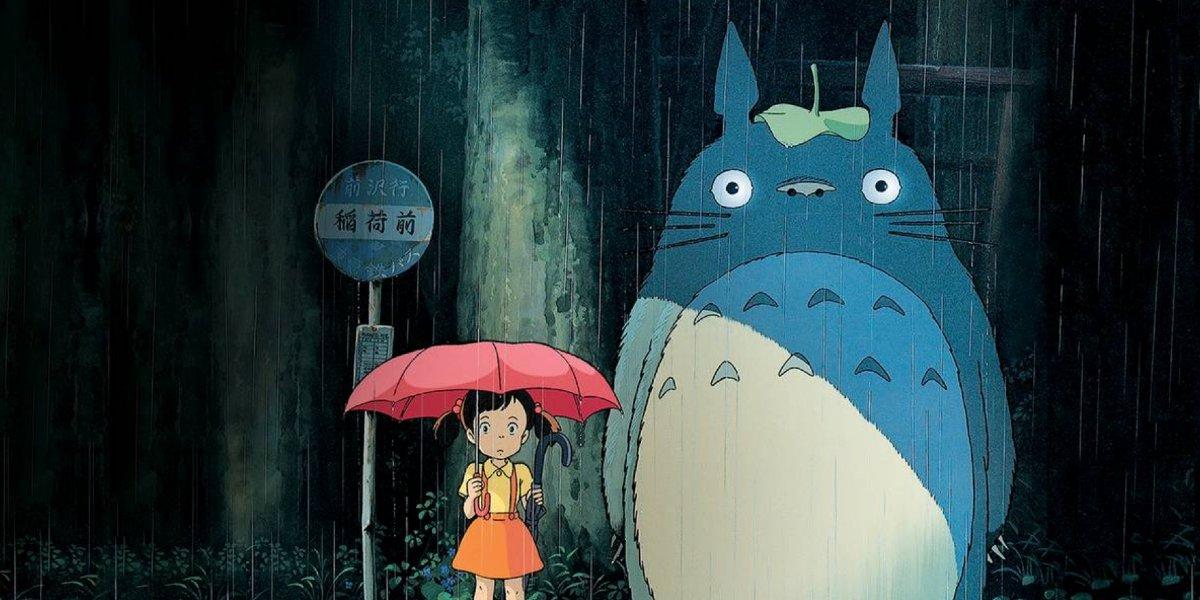 Satsuki Kusakabe and Totoro standing in the rain in My Neighbor Totoro