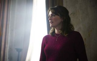 Former Call the Midwife star Charlotte Ritchie staring out of a window in her new BBC1 comedy Ghosts