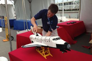 Master LEGO Builder Ed Diment with Space Shuttle Enterprise Model