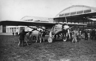 Charles Lindbergh arrives at Le Bourget, near Paris, in his Spirit of St. Louis aircraft on May 21, 1927.