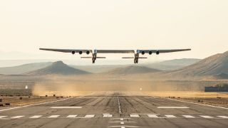 Stratolaunch's rocket carrier plane, the largest aircraft ever built, takes off from the Mojave Air and Space Port in Mojave, California during its first test flight on April 13, 2019.