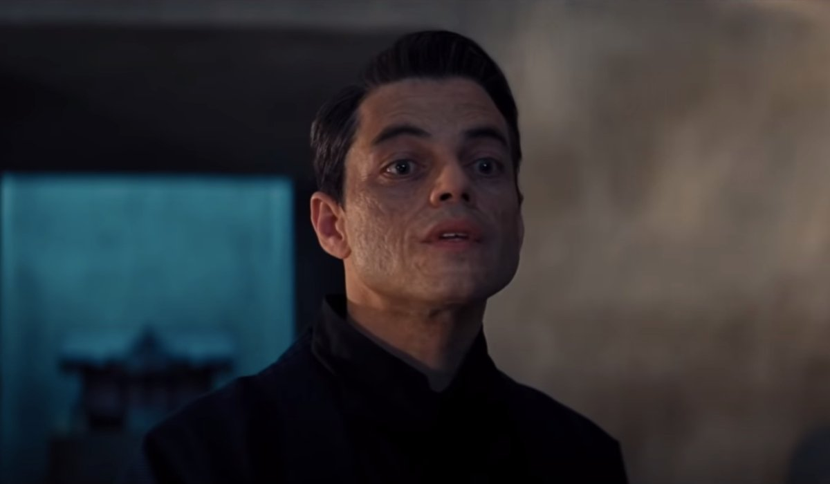 No Time To Die Rami Malek lifts his face in conversation