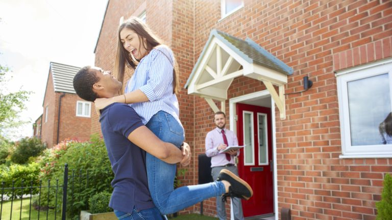 homeowners celebrating buying their first home