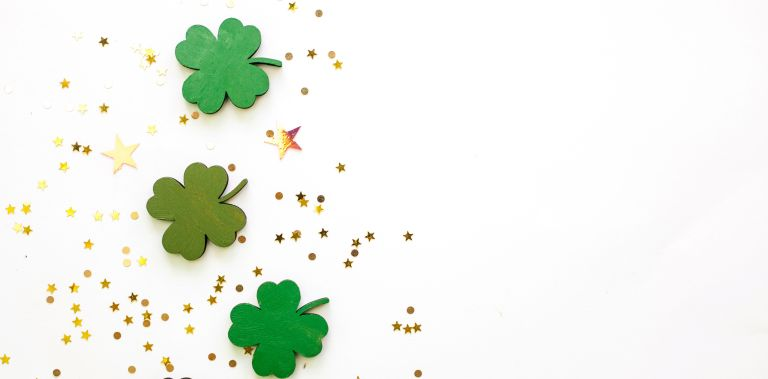 Green Clovers or Shamrocks and confetti white Background for St. Patrick's Day Holiday