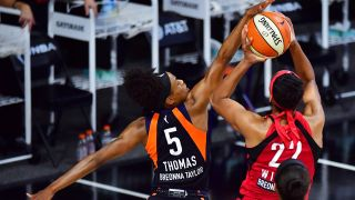 A'ja Wilson of the Las Vegas Aces draws the foul from Jasmine Thomas of the Connecticut Sun during the second half of Game Three of their Third Round playoff at Feld Entertainment Center on Sept. 24, 2020 in Palmetto, Florida.