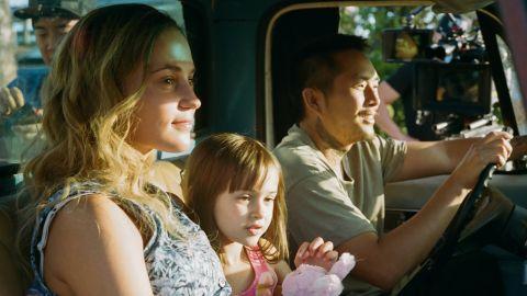 Alicia Vikander, Sydney Kowalske, and Justin Chon in 'Blue Bayou'.