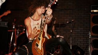 """Slash of the rock group 'Guns n' Roses' performs onstage on the night they played """"Paradise City"""" for the first time at the Troubadour on October 10, 1985 in Los Angeles, California"""