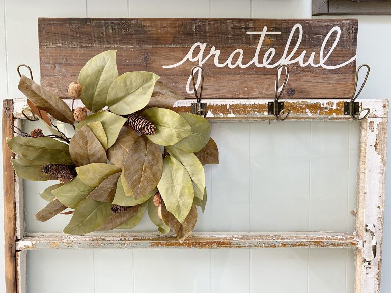 Dried wreath hanging on entryway hooks